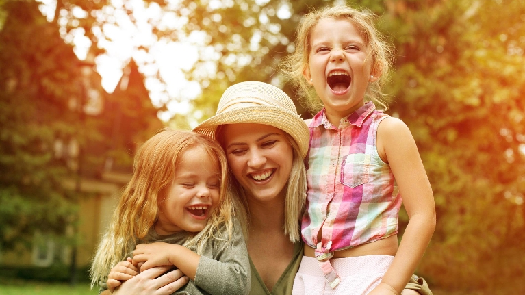 mom laughing with daughters
