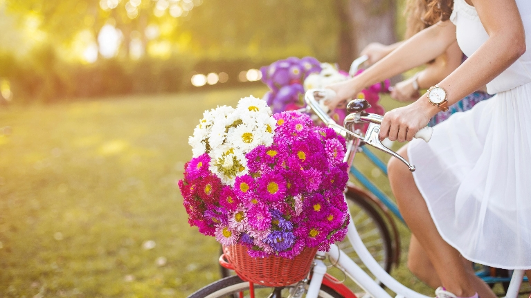 woman on bike with flowers