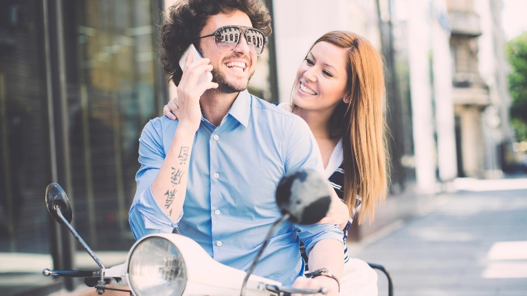 Guy and girl on motorcycle